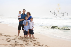 family poses at beach