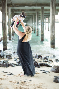 mom daughter under pier