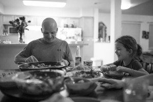 dad serves dinner to daughter