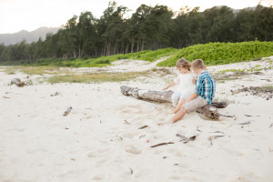 kids play on log on beach