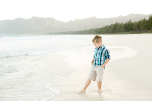 boy dips toes in ocean