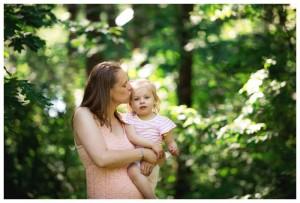 mom kisses daughter