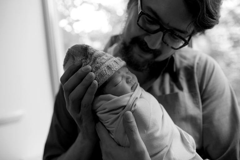 dad holding newborn baby